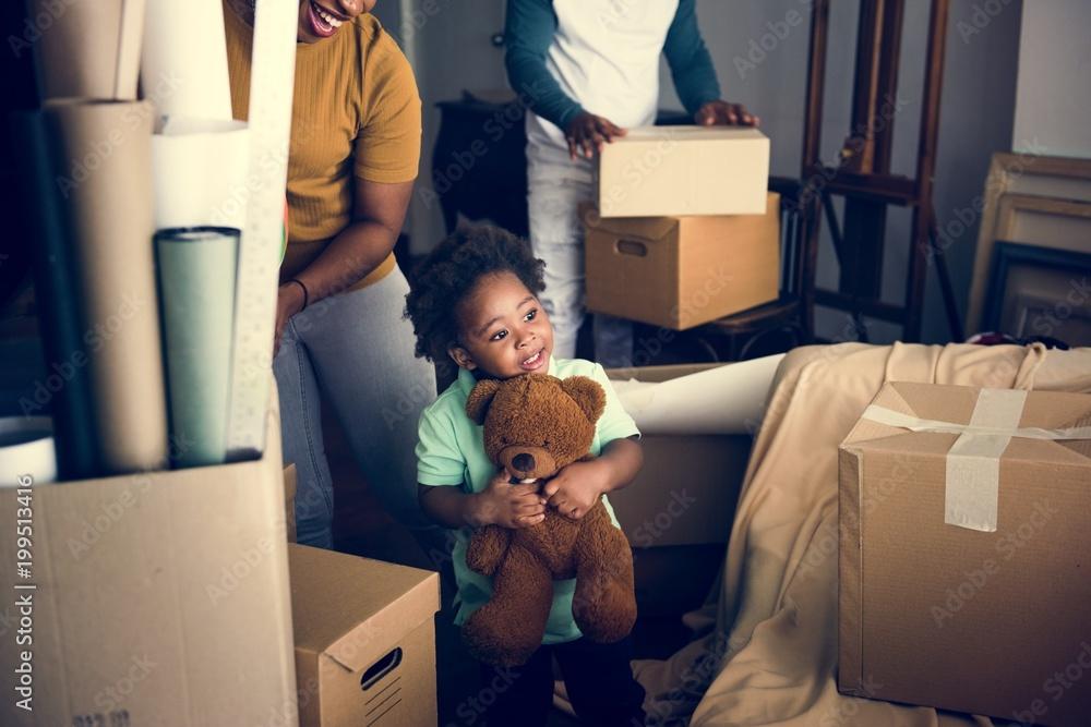 Fototapety, obrazy: Black family moving to new house