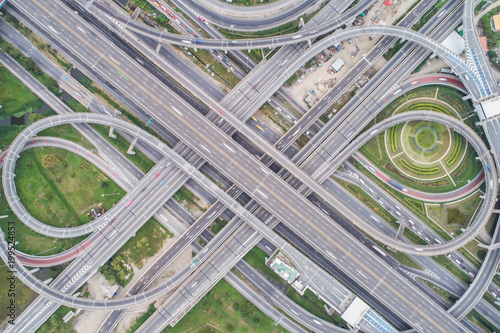 Aerial day view of traffic junction cross road