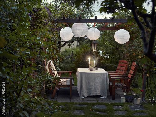Fotobehang Tuin Table set in garden