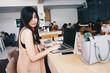 Business women sitting in modern coffee shop using laptop