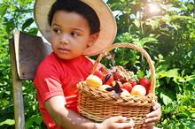 Boy Sitting With A Basket Of B...