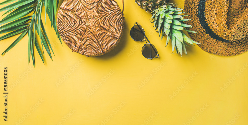 Fototapety, obrazy: Colorful summer female fashion outfit flat-lay. Straw hat, bamboo bag, sunglasses, palm branches, pineapple over yellow background, top view, copy space, wide composition. Summer fashion, holiday