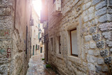 Fototapeta Uliczki - Old stone town in Kotor. Narrow streets among houses