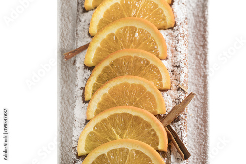 Fotografie, Obraz  Fette di arancia su dolce al cioccolato