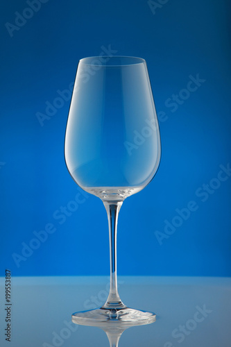 empty wineglass/ empty wineglass on blue background
