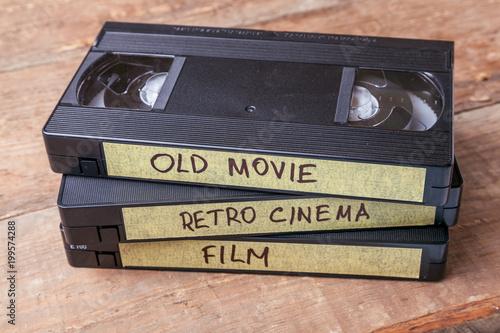 Billede på lærred Cassettes VHS with old films on wooden boards