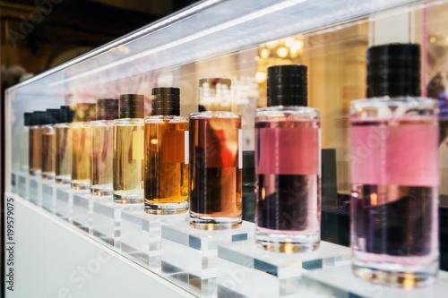 Fototapeta toilet perfume different smells on the shelf in the Department store obraz