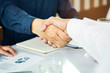 entrepreneur signed contract loan financial. young businessman and financial agent shaking hands together after deal budget loan for expand business to service clients is done.