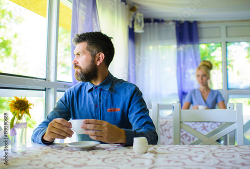 Man with serious face nervous about date, wait for girlfriend. Wallpaper Mural