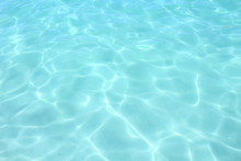 Beautiful Clear Blue Sea. Close-up. Background. Texture.