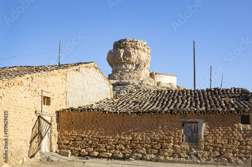 фотография  antique houses made of clay and the tower (castle) at Aguilar de Montuenga villa