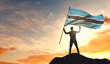 Botswana flag being waved by a man celebrating success at the top of a mountain. 3D Rendering