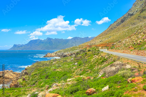 Foto op Canvas Zuid Afrika Scenic coastal Route 44 or Clarence Drive on False Bay near Cape Town between Gordon's Bay and Pringle Bay in Western Cape, South Africa. Hottentots Holland Mountain range on background. Summer season