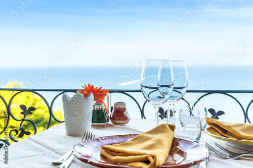 Restaurant table overlooking the sea on the Amalfi coast in Italy.