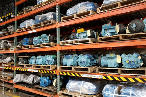 Shelves are stacked with compressors for air conditioning