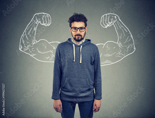 confident strong man hipster on wall background Tablou Canvas