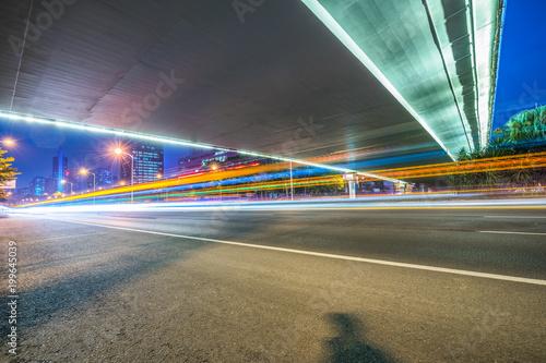 Foto op Plexiglas F1 Vehicle light trails in city at night.