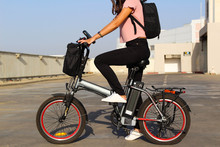 A Young Woman With An Electric Bicycle