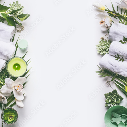 Keuken foto achterwand Spa Green spa or wellness layout frame with towels, candle, tropical leaves , orchid flowers, succulents and body and face care tools and accessories on white background, top view.