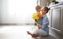 Happy Mother's Day! Baby Son Gives Flowersfor  Mother On Holiday .