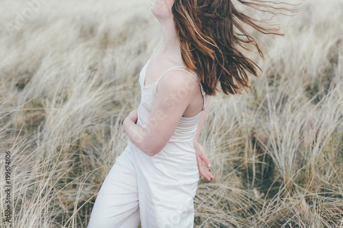 Foto op Plexiglas Cultuur Woman dancing in the grasses