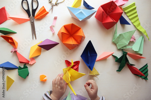the child makes origami Canvas Print