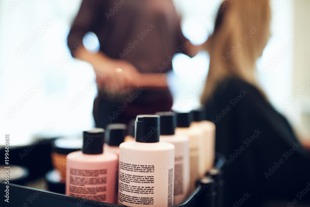 Fototapety, obrazy: Bottles of styling products in a hair salon