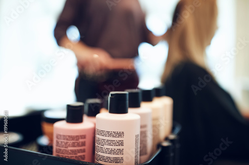 Bottles of styling products in a hair salon