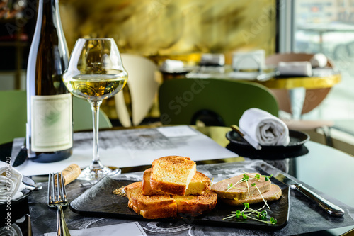 Spoed Foto op Canvas Klaar gerecht Tasty foie Gras with toasts and glass of white wine at a restaurant