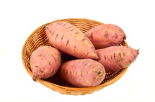 Health Benefits Of Sweet Potatoes Or Yams. Sweet Potatoes In Basket On White Background