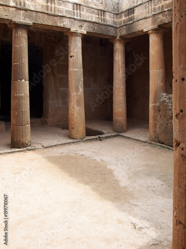 Corner and door of the ancient burial chamber with columns and doorway of tomb number 3 at the 'Tomb of the Kings' necropolis in Paphos, Cyprus Fototapeta