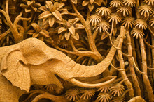 Handmade Wood Carving Of An Elephant In A Jungle Done By Thai Craftsman