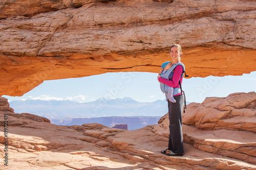 Deurstickers Oranje eclat A mother and her baby son visit Canyonlands National park in Utah, USA