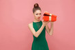 Woman unboxing red gift box looking inside, ahve sadness look