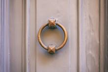 Old Brass Door Knocker On A Gr...