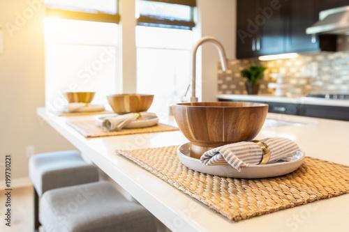 Fototapeta Wooden Bowl Place Settings on Kitchen Island Abstract obraz