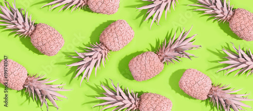 Painted pineapples on a vivid green background