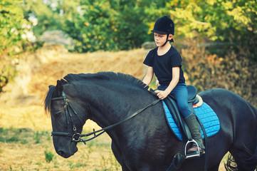 cheerful boy riding a horse, walking