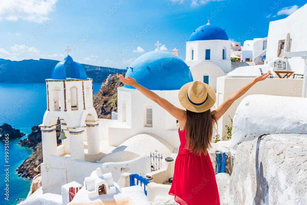 Fototapety, obrazy: Europe travel happy vacation woman. Girl tourist having fun with open arms in freedom in Santorini cruise holiday, summer european destination. Red dress and hat person.
