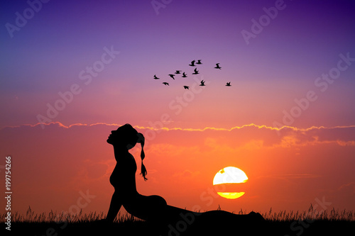 Deurstickers Baksteen cobra yoga pose at sunset