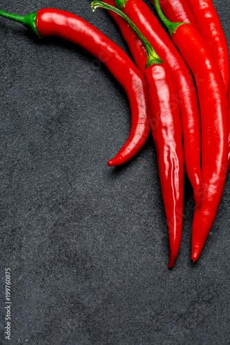 In de dag Hot chili peppers red chili pepper on dark concrete background