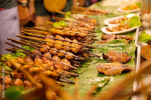 In de dag Bangkok Closeup Of Chicken Satays At Market Stall