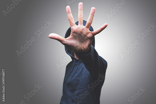 Photo view of a man showing his hand hiding his face