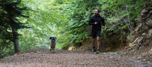 Man Running With His Dog Aroun...
