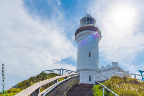 View over Cape Byron lighthouse, the Most Easterly Point on the Australian Mainland with green turquoise water waves in Byron Bay, Australia Poster Mural XXL