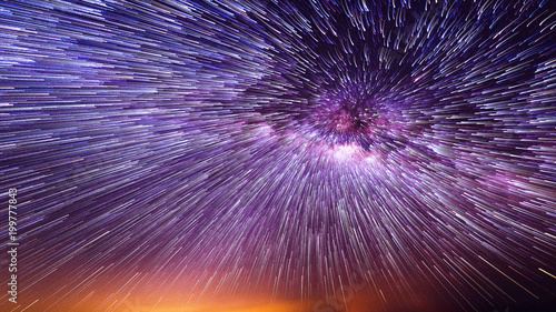 Foto  Night sky with vortex star trails.