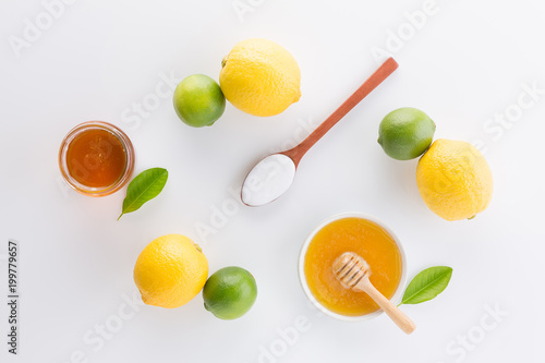 Poster Dairy products Homemade yogurt with honey and lemon on white background from top view. Flat lay