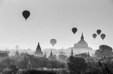 Hot Air Balloons Flying At Sunrise Over Ancient Buddhist Temples At Bagan. Myanmar (Burma) Travel Landscape And Destinations. Black And White Image.