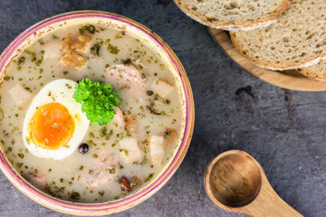 Zurek - polish Easter soup with eggs and white sausage - closeup