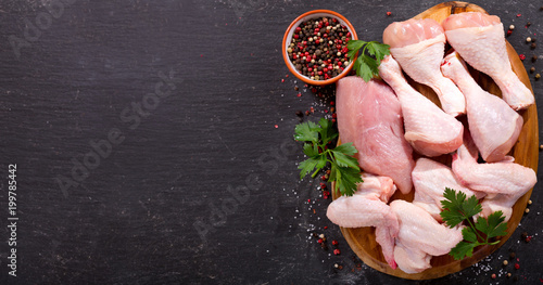 fresh chicken meat on dark board